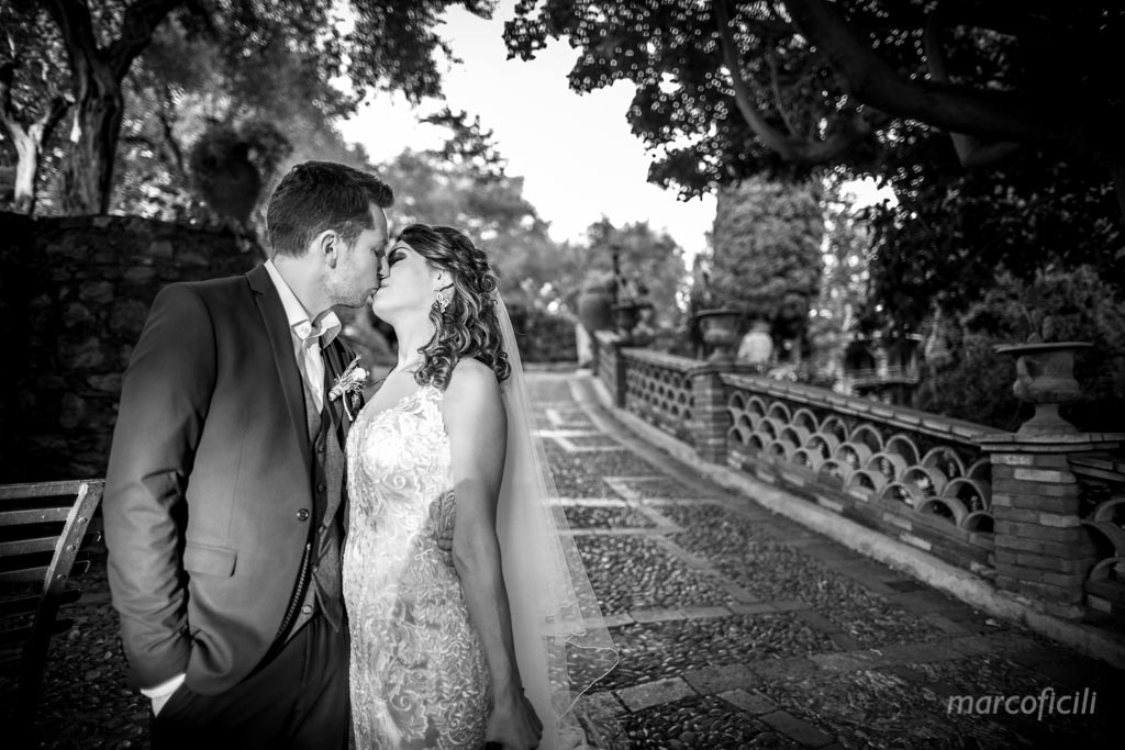 Wedding Taormina Varò church _Sicily__best_photographer_videographer_bride_groom_kiss_B&W_veil