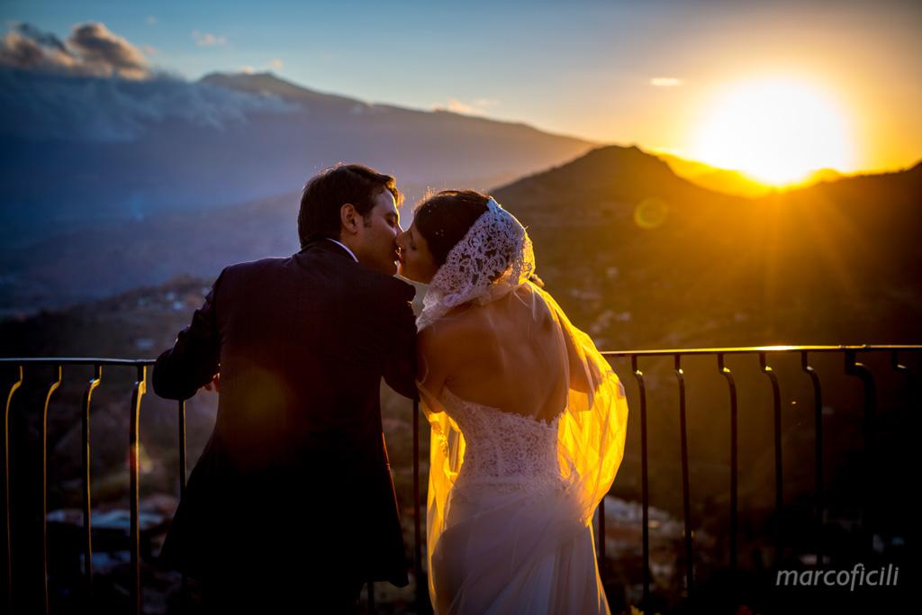 Wedding Madonna della Rocca Taormina, sunset, bride, groom, kiss
