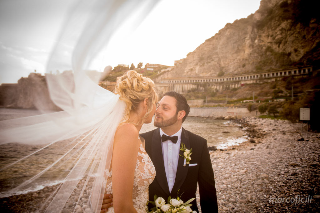 La Plage Resort, Taormina, sea, beach, kiss, wedding, Bride and Groom, sunset, veil