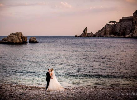 Taormina, sea, beach, wedding, bride, groom, kiss, veil, sunset
